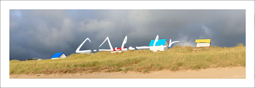 Beach cabins on dunes of Gouville-sur-Mer, panoramic view, Cotentin, Normandy, France. Photo poster and art print. Image Gallery and picture Christophe Schambert